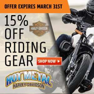 banner ad with harley davidson rider riding in rain with riding gear