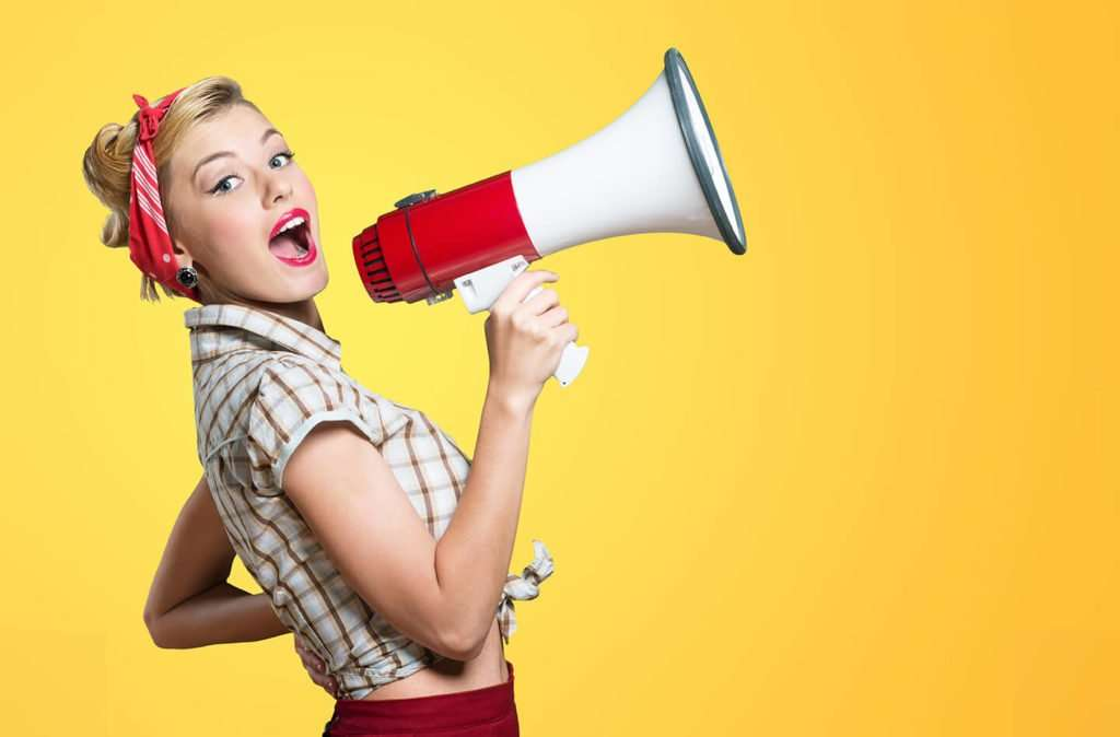 woman yelling into red megaphone a brand strategy message