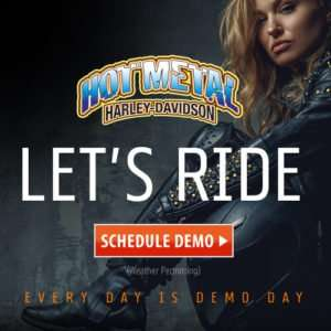 banner ad with women in leather outfit ready to demo and test ride a harley davidson motorcycle